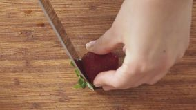 Woman cutting strawberry stock footage