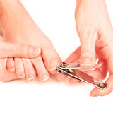Woman cutting toenails Royalty Free Stock Image