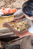 Woman cutting tofu, Myanmar Stock Image