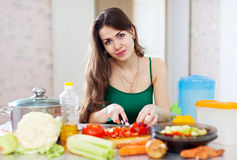 Woman cutting tomato Stock Photos