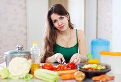 Woman cutting tomato Stock Photos