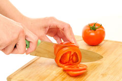 Woman cutting tomato Stock Photo