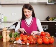 Woman cutting  tomatoes Stock Image