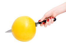 Woman cutting tropical citrus fruit Royalty Free Stock Photos