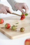 Woman cutting up fruit Stock Photos