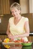 Woman Cutting Up Vegetables Royalty Free Stock Image