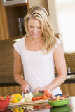 Woman Cutting Vegetables Royalty Free Stock Image