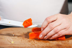 Woman cutting vegetables Royalty Free Stock Photos
