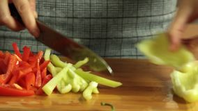 Woman cutting vegetables and cooking sweet potato quesadilla. Woman cutting onion and red pepper vegetables on wooden cutting board and cooking sweet potato stock video