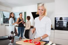 Woman cutting vegetables on counter Stock Photography