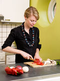 Woman Cutting Vegetables at Ho Royalty Free Stock Photography