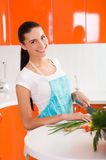 Woman cutting vegetables in kitchen interior Royalty Free Stock Photography