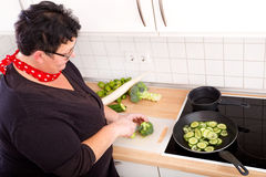 Woman cutting vegetables Stock Photo