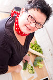 Woman cutting vegetables Stock Images