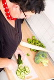 Woman cutting vegetables Stock Photos