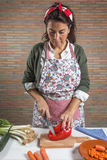 Woman cutting vegetables on wooden board stock photos
