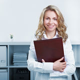 Woman with CV and resume. Happy blonde woman with CV and resume in the office stock photos