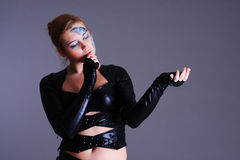 Woman in cyber style clothing and make-up Royalty Free Stock Photo