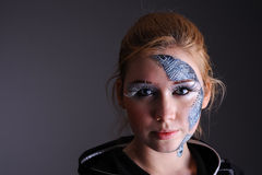 Woman in cyber style clothing and make-up Stock Photos