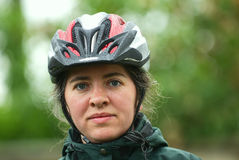 Woman in cycle helmet Stock Photography