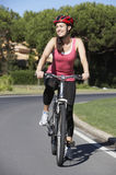 Woman On Cycle Ride Stock Photo