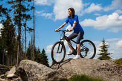 Woman cycling. In mountain scenery Stock Image