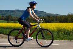 Woman cycling Royalty Free Stock Image