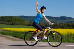 Woman cycling Royalty Free Stock Photos