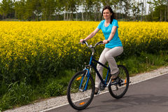 Woman cycling Stock Images