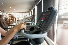 Woman cycling burn fat on bicycle cardio machine in fitness gym Royalty Free Stock Photography