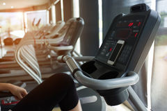 Woman cycling burn fat on bicycle cardio machine in fitness gym Royalty Free Stock Photos