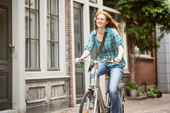 Woman Cycling in a City Royalty Free Stock Photo