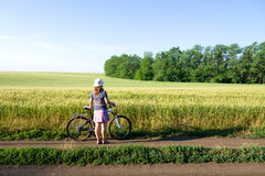 Woman cycling countryside Royalty Free Stock Photography