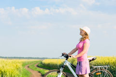 Woman cycling countryside Royalty Free Stock Photos