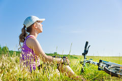 woman cycling countryside Stock Photography