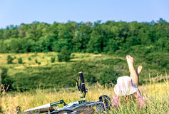 Woman cycling countryside Royalty Free Stock Photo