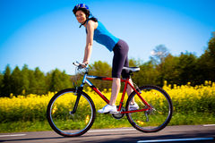 Woman cycling. On cycle lane Stock Photography