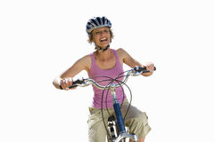 Woman cycling and laughing, cut out Stock Photos