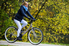 Woman cycling. Mature woman cycling in park Stock Photo