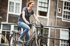 Woman Cycling in Old Town Stock Image