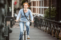 Woman Cycling in an Old Town Royalty Free Stock Photography