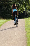 Woman cycling in park Royalty Free Stock Photo