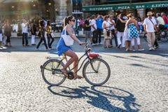 Woman cycling at Piazza Bra in Verona Royalty Free Stock Image