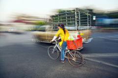 Woman is cycling in the streets of Bangkok in the early morning Stock Images