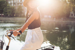 Woman cycling on a summer day Stock Image