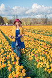 Woman cycling on a sunny day Stock Image