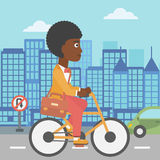 Woman cycling to work. An african-american woman with a briefcase cycling to work on city background vector flat design illustration. Square layout Stock Photography