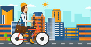Woman cycling to work. A woman with a briefcase cycling to work on city background vector flat design illustration. Horizontal layout Royalty Free Stock Photography