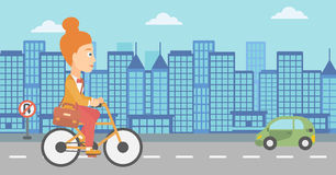 Woman cycling to work. A woman with a briefcase cycling to work on city background vector flat design illustration. Horizontal layout Royalty Free Stock Photos