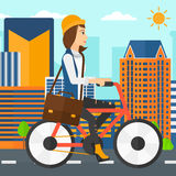 Woman cycling to work. A woman with a briefcase cycling to work on city background vector flat design illustration. Square layout Royalty Free Stock Image